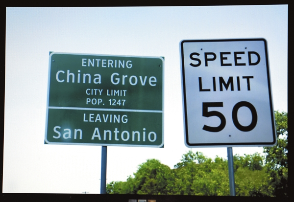 A traffic sign at the entrance of China Grove, TX when leaving San Antonio.